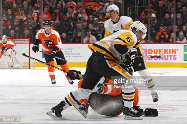 Jamie Oleksiak of the Pittsburgh Penguins checks Jakub Voracek of the Philadelphia Flyers during the second period at Wells Fargo Center on January 2...