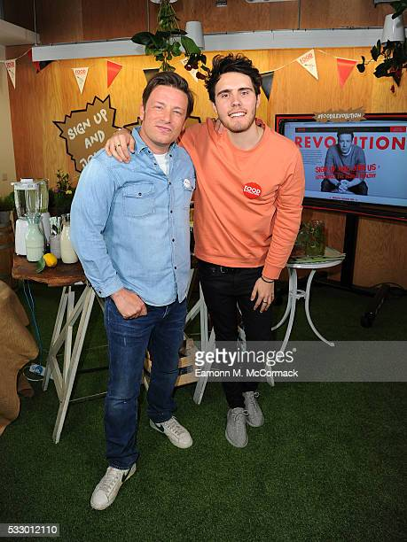 Jamie Oliver and Alfie Deyes take part in Jamie Oliver's Food Revolution Day on May 20 2016 in London United Kingdom Jamie Oliver launches a Facebook...