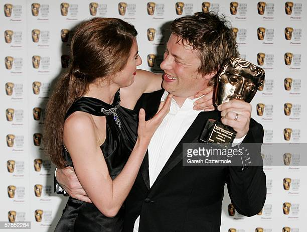 Jamie Oliver and his wife Jools pose in the Awards Room with the award for Factual Series for Jamie's School Dinners at the Pioneer British Academy...