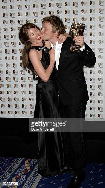 Jamie Oliver and his wife Jools pose in the Awards Room with the award for Factual Series for 'Jamie's School Dinners' at the Pioneer British Academy...