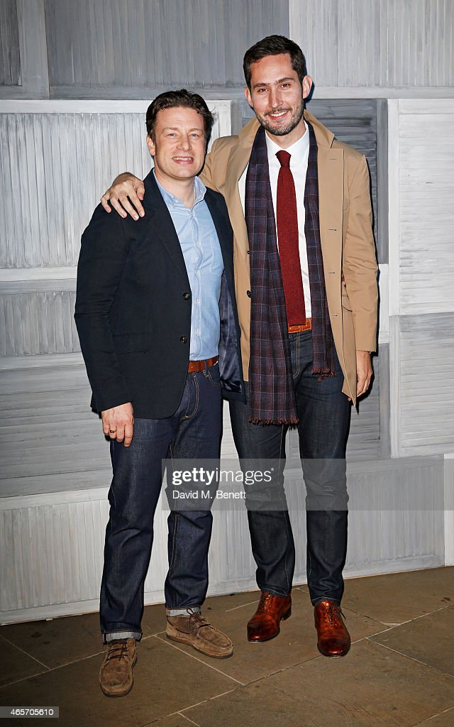 Jamie Oliver (L) and Instagram's Kevin Systrom arrives at their second annual private party, taking place at Barbecoa on March 9, 2015 in London, England.
