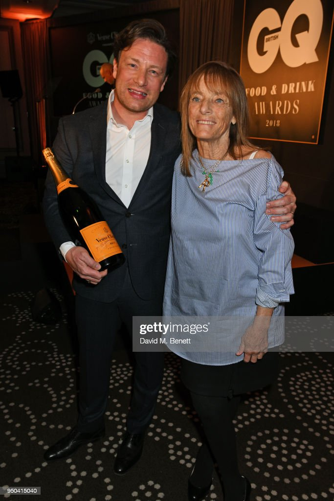 Jamie Oliver (L) and Lady Ruth Rogers, winner of the Lifetime Achievement award, attend the GQ Food & Drink Awards at Rosewood London on April 23, 2018 in London, England.