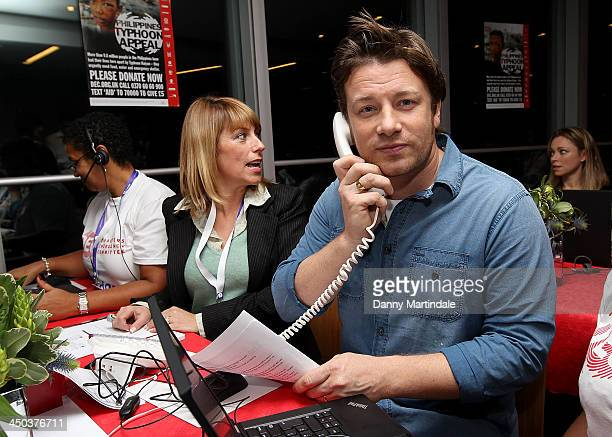 Jamie Oliver answers phones at a fundraising telethon to raise money for the DEC Philippines Typhoon Appeal on November 18 2013 in London England
