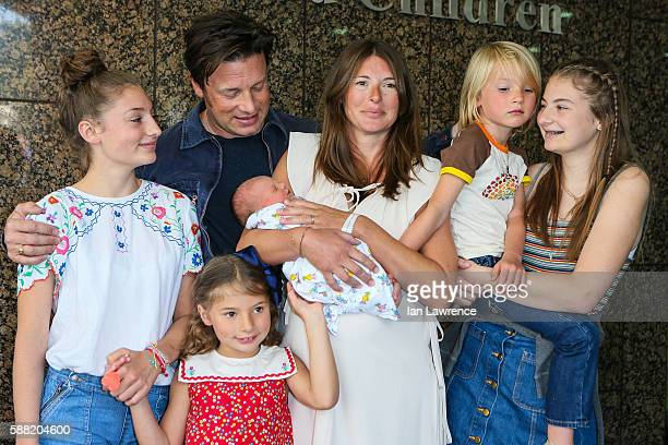 Jamie Oliver Jools Oliver and their family pose with their new baby at The Portland Street Hospital on August 8 2016 in London England