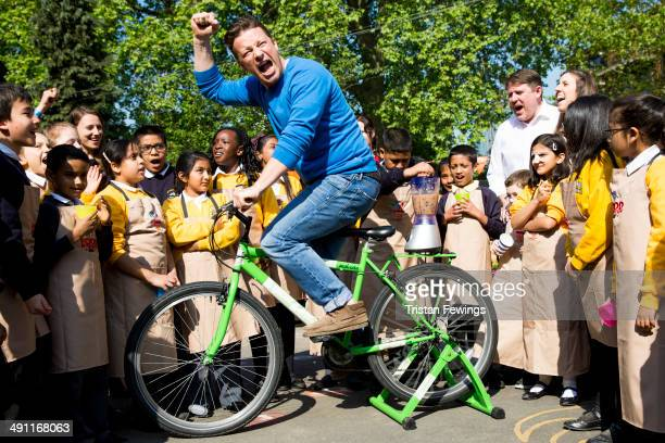 Jamie Oliver powers a blender by riding a bike as he joins children from St Paul's Whitechapel CE Primary school to celebrate the third annual Food...