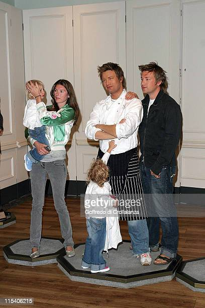 Jamie Oliver with his wife Jools and children during Jamie Oliver Unveils His Waxwork at Madame Tussauds in London at Madame Tussauds in London Great...