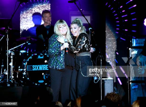 Jamie O'Neal and Lauren Alaina perform onstage at ACM Lifting Lives® Decades on April 06 2019 in Las Vegas Nevada
