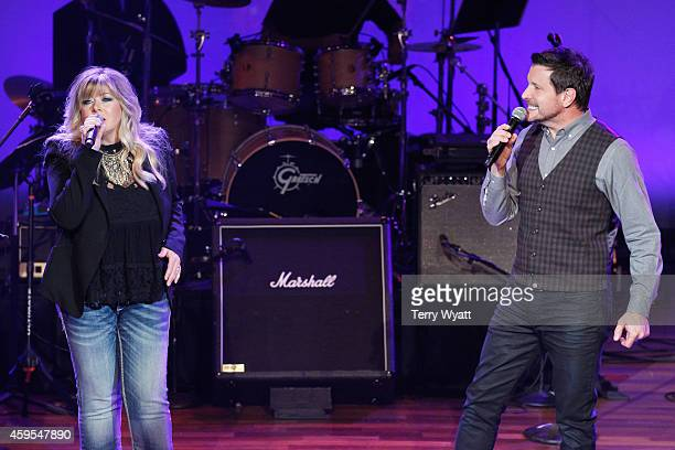 Jamie O'Neal and Ty Herndon perform during Charlie Daniels Friends Christmas 4 Kids 2014 at the Ryman Auditorium on November 24 2014 in Nashville...