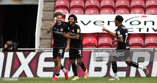 Jamie Paterson is congratulated by team mates Jay Dasilva and Korey Smith after scoring the second goal during the Sky Bet Championship match between...