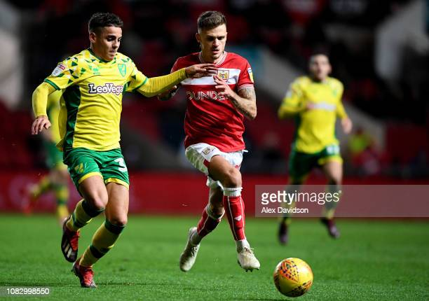 Jamie Paterson of Bristol City and Max Aarons of Norwich City compete for the ball during the Sky Bet Championship match between Bristol City and...
