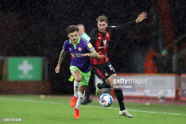 Jamie Paterson of Bristol City battles for possession with Jack Stacey of AFC Bournemouth during the Sky Bet Championship match between AFC...