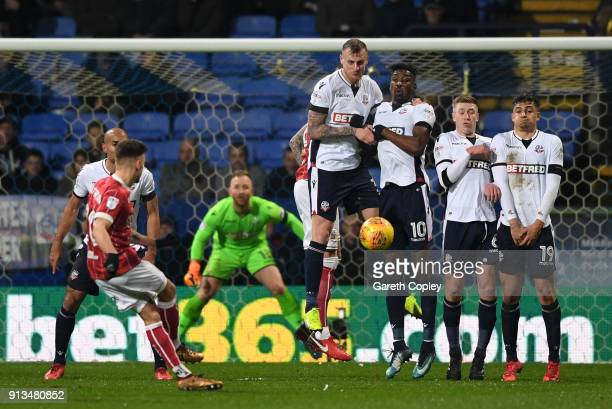 Jamie Paterson of Bristol City fires in a free kick as the Bolton Wanderers wall look on during the Sky Bet Championship match between Bolton...