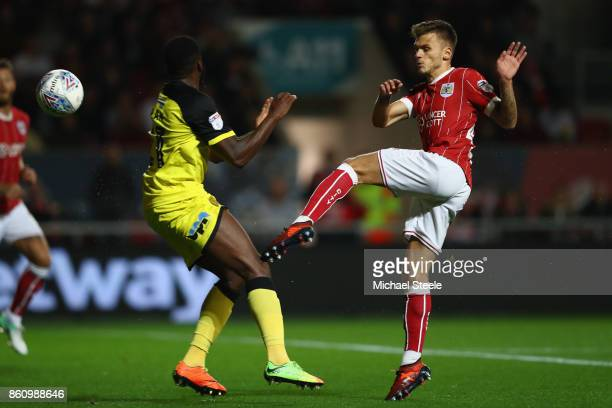Jamie Paterson of Bristol City has a shot blocked by Hope Akpan of Burton during the Sky Bet Championship match between Bristol City and Burton...