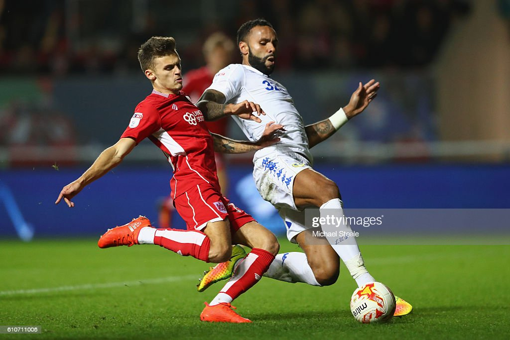 Jamie Paterson (L) of Bristol City has a shot blocked by Kyle Bartley of Leeds United during the Sky Bet Championship match between Bristol City and Leeds United at Ashton Gate on September 27, 2016 in Bristol, England.