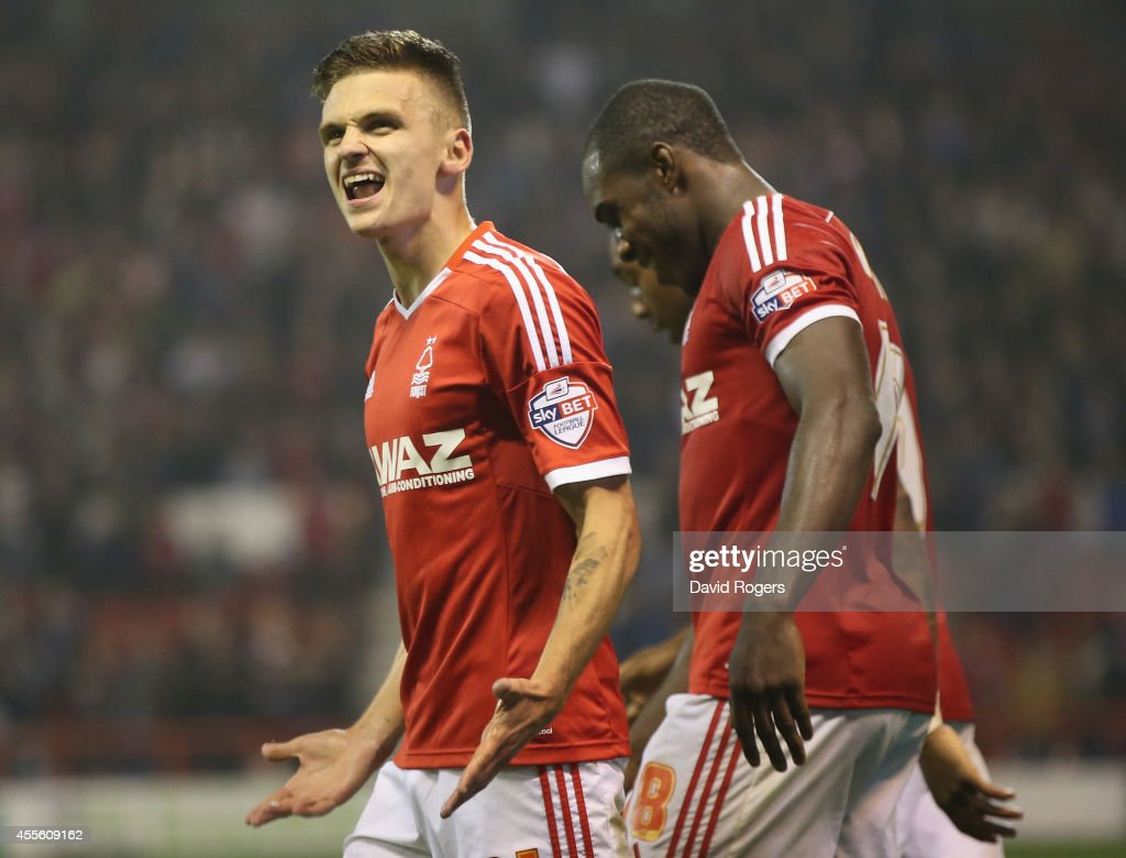 Jamie Paterson of Nottingham Fores celebrates after scoring their fifth goal during the Sky Bet Championship match between Nottingham Forest and Fulham at the City Ground on September 17, 2014 in Nottingham, England.