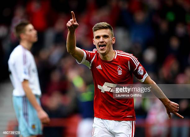 Jamie Paterson of Nottingham Forest celebrates as he scores their fourth goal and completes his hat trick during the FA Cup with Budweiser Third...