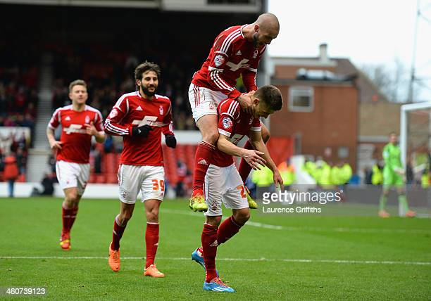Jamie Paterson of Nottingham Forest celebrates scoring his third goal with Henri Lansbury goal during the Budweiser FA Cup Third Round match between...