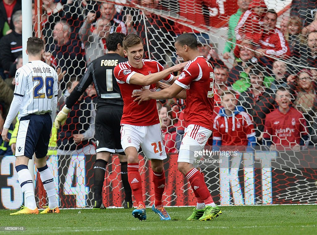 Jamie Paterson of Nottingham Forest (L) celebrates scoring their first goal during the Sky Bet Championship match between Nottingham Forest and Millwall at City Ground on April 05, 2014 in Nottingham, England,