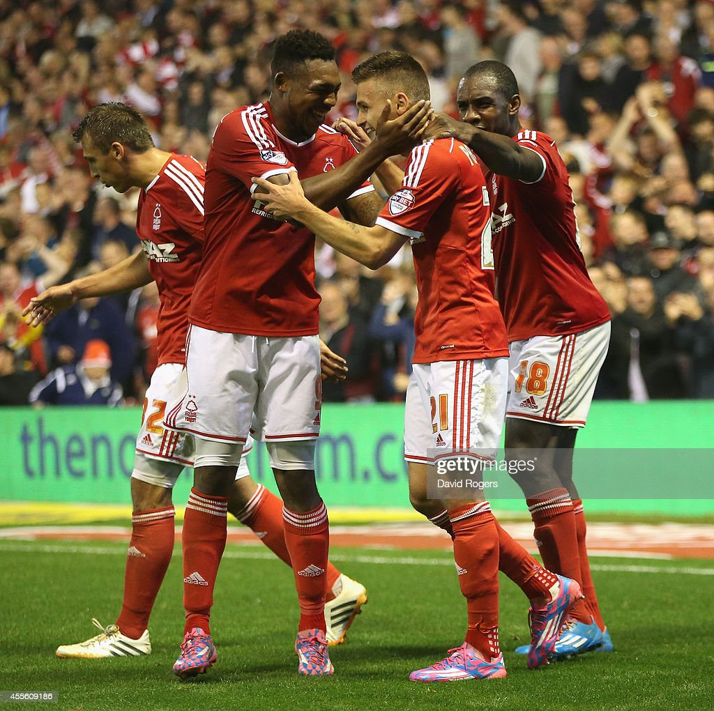 Jamie Paterson of Nottingham Forest celebrates with team mates Britt Assombalonga (L) and Michail Antonio after scoring their fifth goal during the Sky Bet Championship match between Nottingham Forest and Fulham at the City Ground on September 17, 2014 in Nottingham, England.