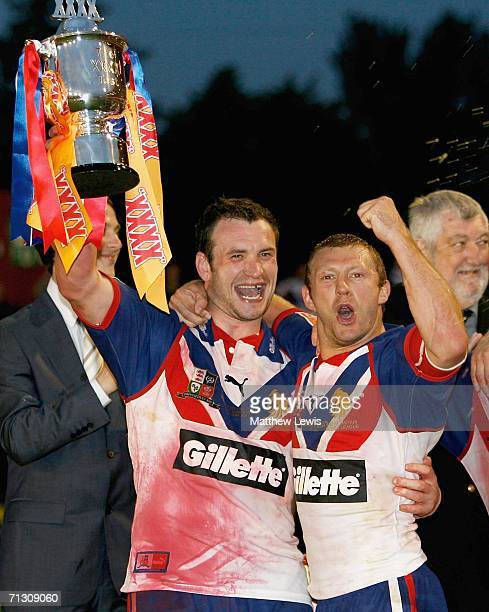 Jamie Peacock and Sean Long of Great Britain celebrate winning the XXXX Trophy during the XXXX Test match between Great Britain and New Zealand at...