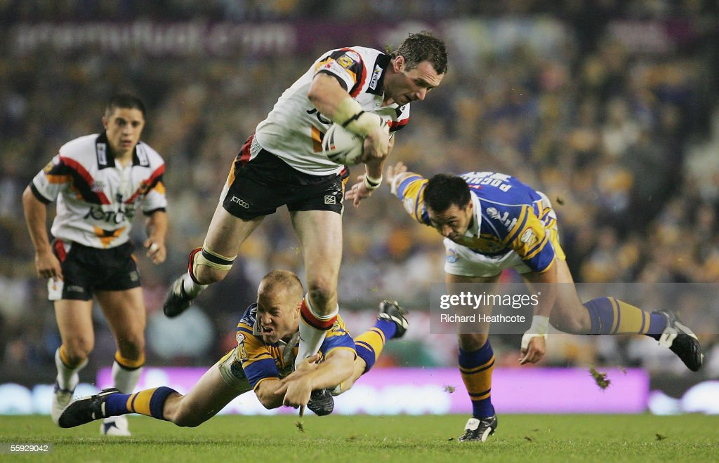 Jamie Peacock of Bradford is tackled by Andrew Dunemann of Leeds during the Engage Super league Grand Final between Leeds Rhinos and Bradford Bulls at Old Trafford on October 15, 2005 in Manchester, England.