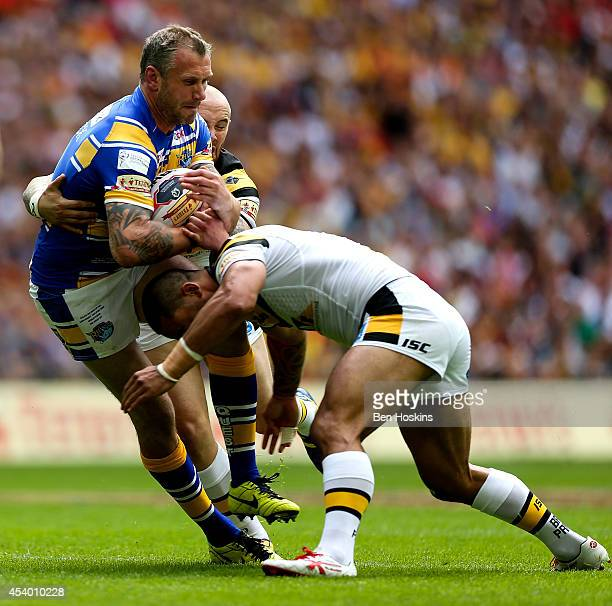 Jamie Peacock of Leeds is tackled by Jamie Ellis of Castleford during the Tetley's Challenge Cup Final between Leeds Rhinos and Castleford Tigers at...