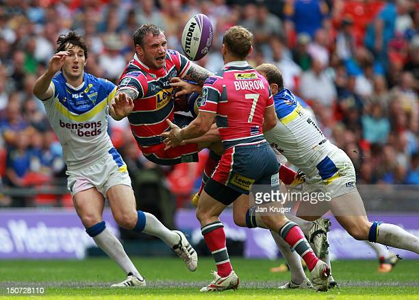 Jamie Peacock of Leeds Rhinos is upended by Ben Westwood of Warrington Wolves during the Carnegie Challenge Cup Final between Leeds Rhinos and...