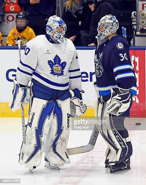 Jamie Phillips of the Manitoba Moose and Garret Sparks of the Toronto Marlies have a chat in warmup prior to a game on December 17 2017 at Ricoh...