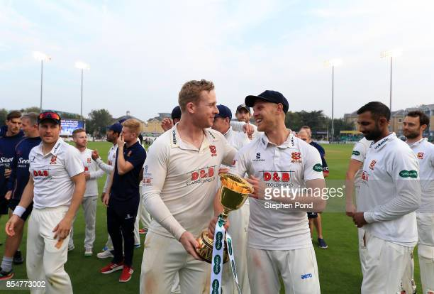 Jamie Porter and Simon Harmer of Essex lift the County Championship trophy during day three of the Specsavers County Championship Division One match...