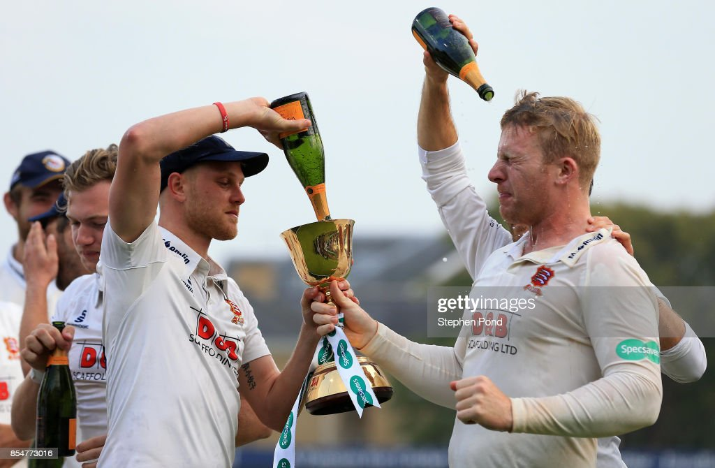 Jamie Porter and Simon Harmer of Essex lift the County Championship trophy during day three of the Specsavers County Championship Division One match between Essex and Yorkshire at the Cloudfm County Ground on September 27, 2017 in Chelmsford, England.