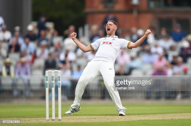 Jamie Porter of Essex celebrates after getting Keaton Jennings of Lancashire out during the Specsavers Championship Division One match between...