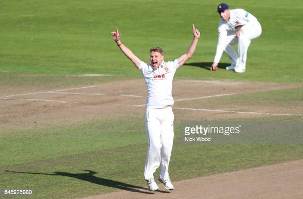 Jamie Porter of Essex celebrates taking the wicket of Sam Hain during the Warwickshire v Essex Specsavers County Championship Division One cricket...