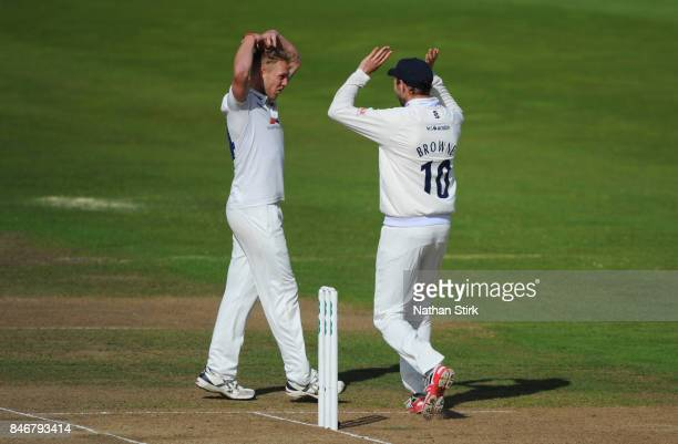 Jamie Porter of Essex celebrates with Nick Browne after getting Sam Hain of Warwickshire out during the County Championship Division One match...