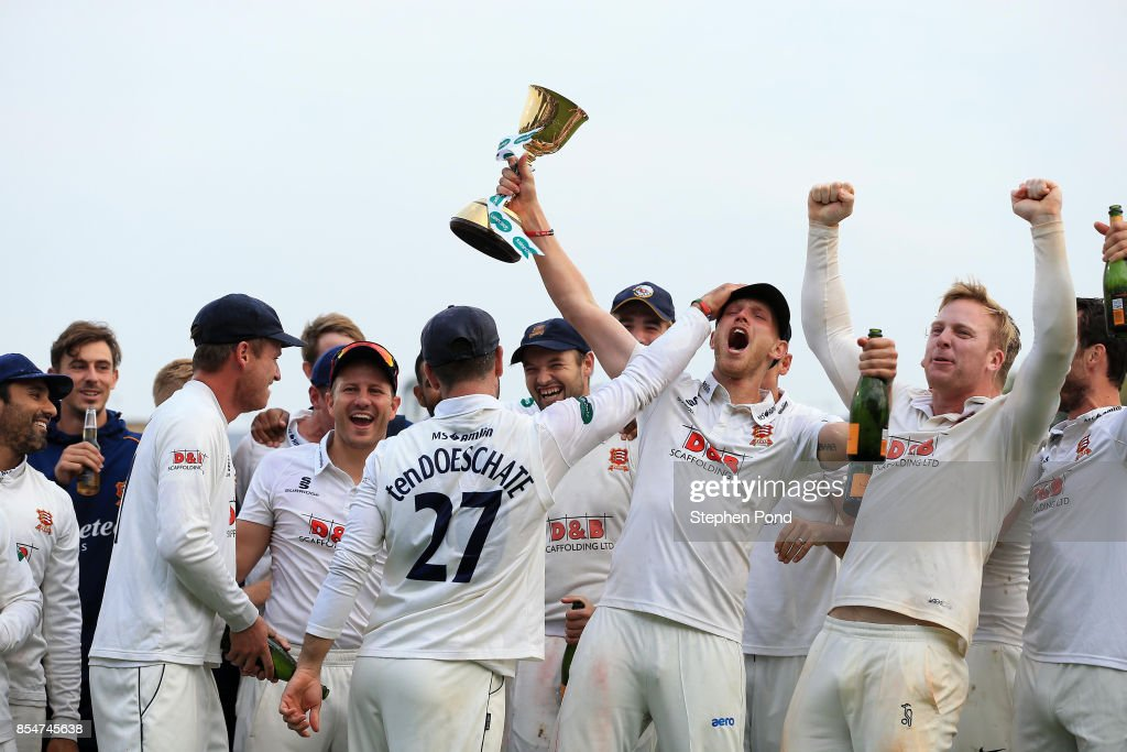 Jamie Porter of Essex lifts the County Championship trophy during day three of the Specsavers County Championship Division One match between Essex and Yorkshire at the Cloudfm County Ground on September 27, 2017 in Chelmsford, England.