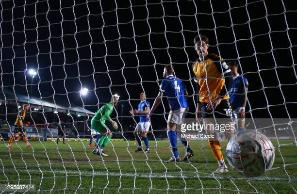 Jamie Proctor of Newport County celebrates as Adam Webster of Brighton and Hove Albion reacts after scoring an own goal for Newport County's first...