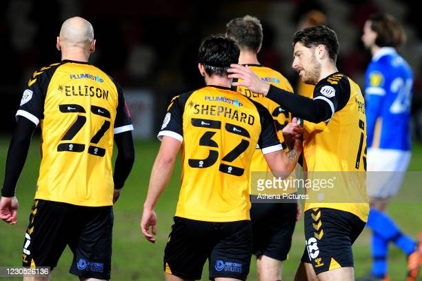 Jamie Proctor of Newport County celebrates scoring his side's equalising goal to make the score 1-1 during the FA Cup Third Round match between...