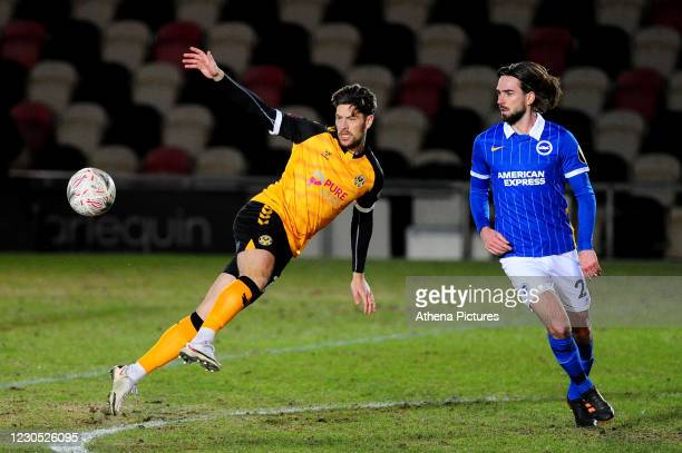 Jamie Proctor of Newport County in action during the FA Cup Third Round match between Newport County and Brighton And Hove Albion at Rodney Parade on...