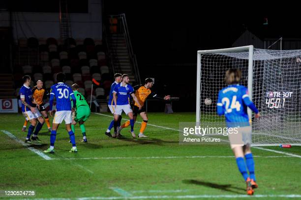 Jamie Proctor of Newport County scores his side's equalising goal to make the score 1-1 during the FA Cup Third Round match between Newport County...