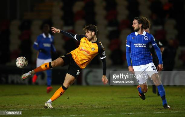 Jamie Proctor of Newport County shoots under pressure from Davy Propper of Brighton and Hove Albion during the FA Cup Third Round match between...