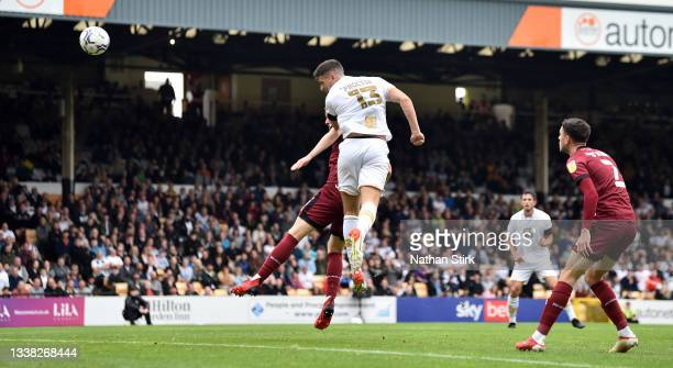 Jamie Proctor of Port Vale scores their first goal during the Sky Bet League Two match between Port Vale and Rochdale at Vale Park on September 04,...