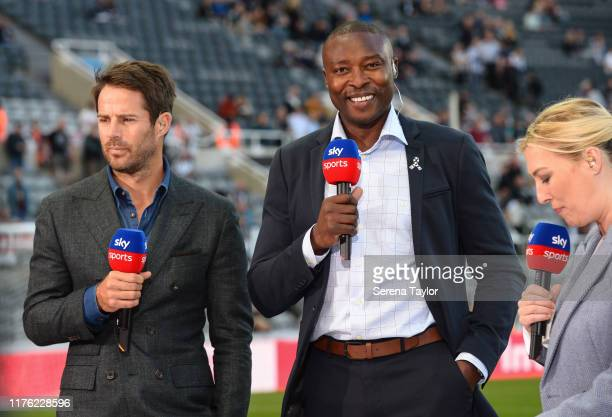 Jamie Redknapp and Ex Newcastle Player Shola Ameobi speak to Sky Sports Presenter Kelly Cates during the Premier League match between Newcastle...