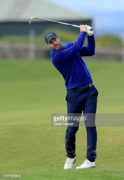 Jamie Redknapp of England plays his second shot on the 17th hole during the third round of the Alfred Dunhill Links Championship on the Old Course at...