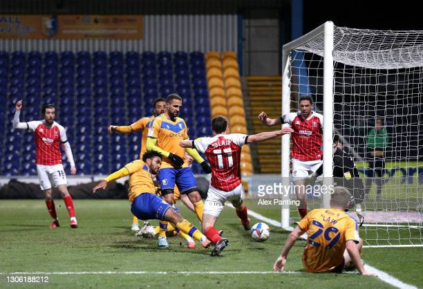 Jamie Reid of Mansfield Town scores their sides second goal during the Sky Bet League Two match between Mansfield Town and Cheltenham Town at One...