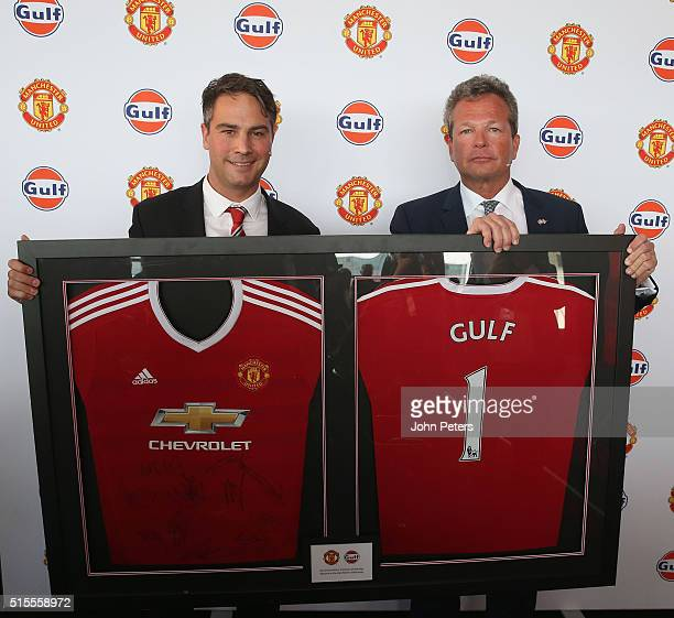 Jamie Reigle Manchester United Commercial Director presents Gulf Oil International vice president Frank Rutten with a signed Manchester United shirt...