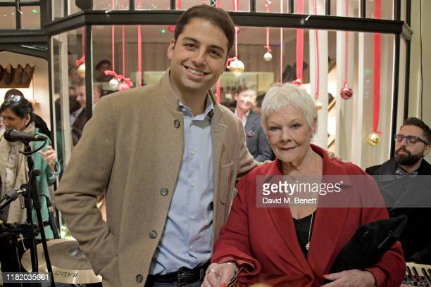 Jamie Reuben and Dame Judi Dench attend the launch of the 200th Burlington Christmas at Burlington Arcade on November 12 2019 in London England