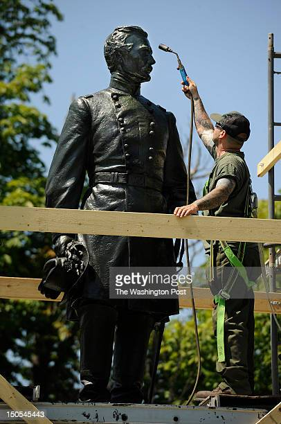 Jamie Revis works on a statue of Major General Andrew Humpreys within the Fredericksburg National Cemetery at the Fredericksburg and Spotsylvania...