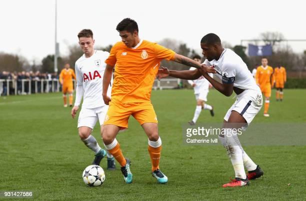 Jamie Reynolds and Japhet Tanganga of Tottenham Hotspur close down Santiago Javier Irala Vera of FC Porto during the UEFA Youth League group H match...