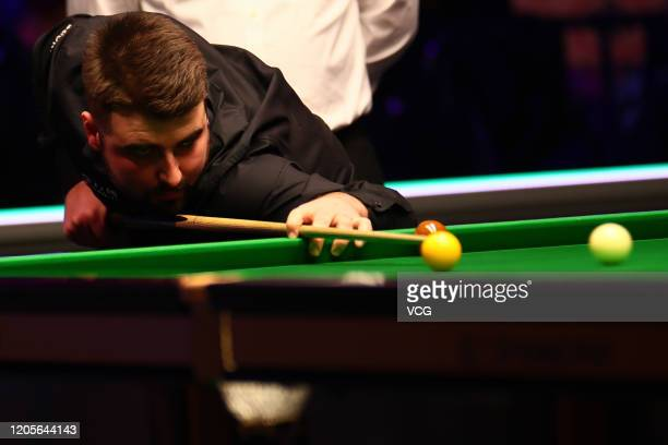 Jamie Rhys Clarke of Wales plays a shot during the 1st round match against Neil Robertson of Australia on day two of the 2020 ManBetX Welsh Open at...