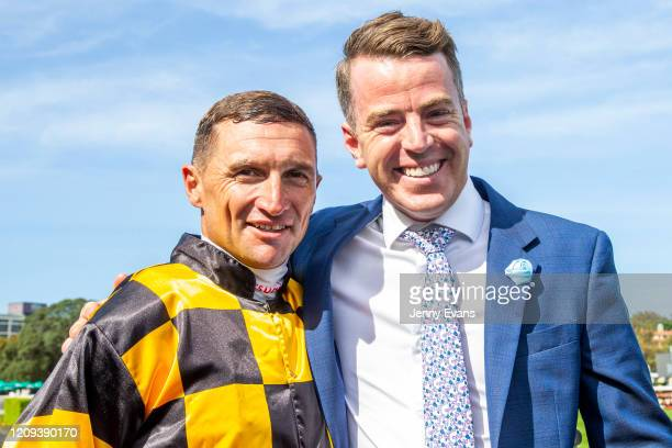 Jamie Richards poses for a photo with Jockey Opie Bosson after winning race 6 the Heineken 3 Surround Stakes during Sydney Racing at Royal Randwick...