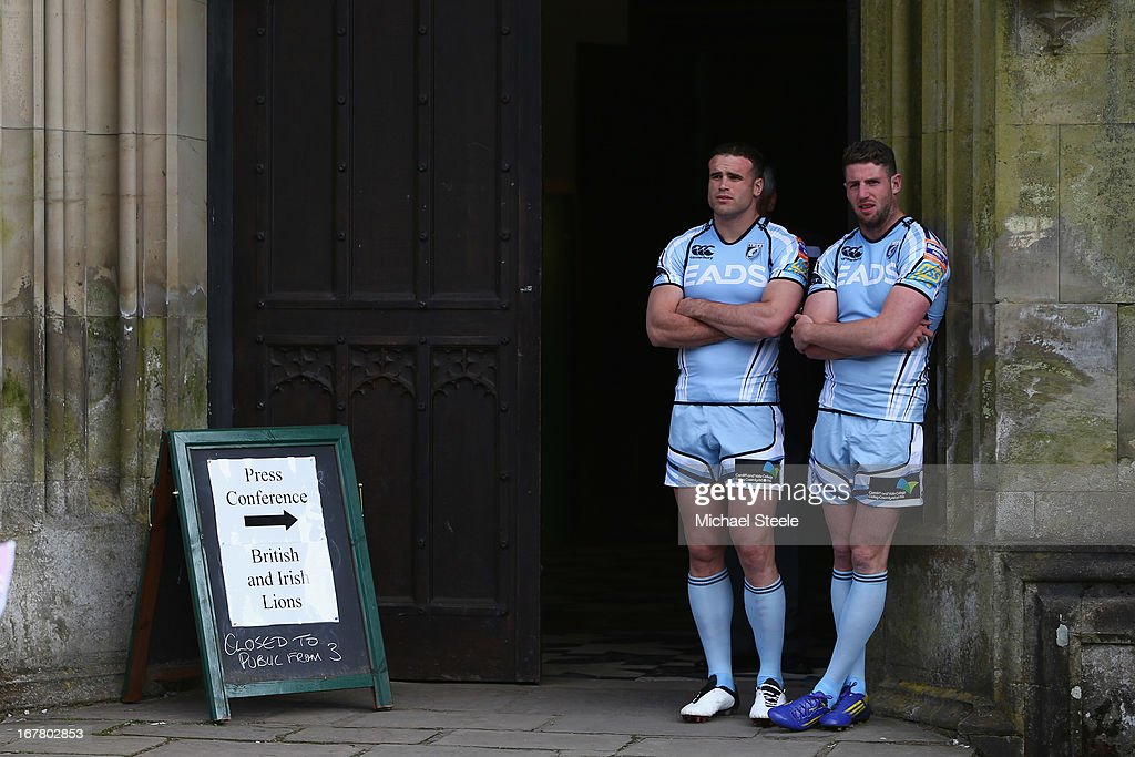 Jamie Roberts (L) and Alex Cuthbert (R) of Cardiff Blues wait outside Margam Castle ahead of a press conference for the Welsh British and Irish Lions players at Margam Country Park on April 30, 2013 in Port Talbot, Wales.